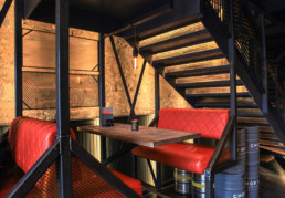 Interior seating of the Chop House Restaurant, displaying an example of Commercial Architectural Design in Edinburgh.